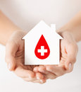 Hands holding house with donor sign Stock Photography