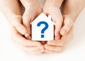 Hands holding house with question mark Stock Photography