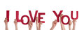 Hands holding i love you many the red words isolated Royalty Free Stock Images