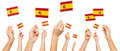 Hands holding the national flags of Spain Royalty Free Stock Photo
