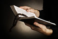 Hands holding open holy   bible Royalty Free Stock Photo