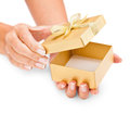 Hands holding an opened gift box isolated on white Royalty Free Stock Photo