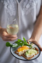 Hands holding party snacks and wine Royalty Free Stock Photo