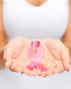 Hands holding pink breast cancer awareness ribbon Royalty Free Stock Photo