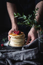 Hands holding plate with stack of pancakes Royalty Free Stock Photo