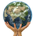 Hands holding realistic globe facing Asia Stock Images