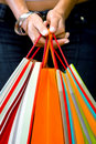 Hands holding shopping bags Royalty Free Stock Photos