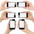 Hands holding smart phones isolated on white background Royalty Free Stock Images