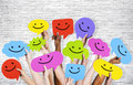 Hands Holding Speech Bubbles with Smiley Faces Icons Royalty Free Stock Photo