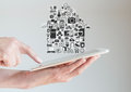 Hands holding tablet with smart home automation and mobility concept