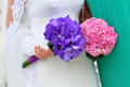 Hands holding wedding bouquet a pink and a purple copy space Royalty Free Stock Photos