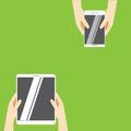 Hands holding white tablet computer and white smartphone on a green background. Vector illustration in flat design.