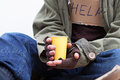 Hands of homeless with a paper cup Royalty Free Stock Photo