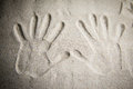 Hands imprints in the sand Royalty Free Stock Photo