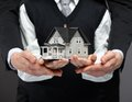Hands keeping house model close up of somebody s concept of real estate and business Stock Photography