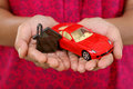 Hands with keys and red toycar Royalty Free Stock Photo