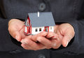 Hands with little house. Royalty Free Stock Photo