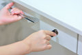 Hands locking and checking drawer female make sure is locked Stock Images