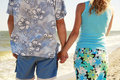 Hands in love couple holding hands on the sea shore a Stock Photo