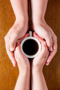 Hands loving couple and a cup of hot coffee Royalty Free Stock Photo