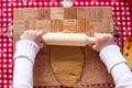 Hands making from dough Christmas gingerbread man Royalty Free Stock Photo