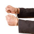 Hands of a man with handcuffs on white background Stock Image
