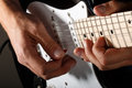 Hands of man playing electric guitar closeup bend technique Royalty Free Stock Photography