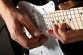 Hands of man playing electric guitar closeup Royalty Free Stock Photo