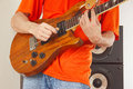 Hands of man put guitar chords closeup Stock Photography