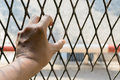 Hands of the man on a steel lattice close up Royalty Free Stock Photo