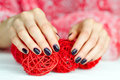 Hands with manicure touching decoration balls Royalty Free Stock Photo