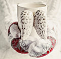 Hands in mittens holding a cup of vintage wings close-up Royalty Free Stock Photo