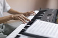 Hands of musician pianist playing on a synthesizer indoor shoot with shallow depth field Stock Photos