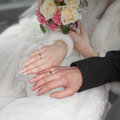 Hands of newly wedded wedding in time wedding ceremony Royalty Free Stock Photography