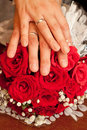 Hands of the newlyweds with flowers a happy couple rings and Royalty Free Stock Image