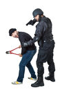 Hands off a scared burglar busted by a swat or police officer Royalty Free Stock Image