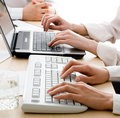 Hands over keyboards Royalty Free Stock Photo