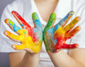 Hands painted in colorful paints little girl and boy Stock Image