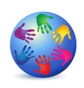 Hands painted with vivid colors on globe Stock Photo