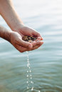 Hands with pebbles and water Royalty Free Stock Photo