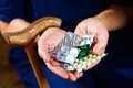 Hands with pills of elderly female pharmaceutical background Royalty Free Stock Photos
