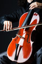 Hands playing cello at the concert Stock Image