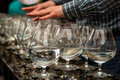 Hands playing on the glasses with water Royalty Free Stock Photo