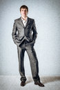 Hands in pockets business man the room and Royalty Free Stock Images