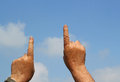Hands pointing upwards two fingers of two up towards the sky Royalty Free Stock Photo