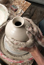 Hands of a potter, creating an earthen jar Royalty Free Stock Image