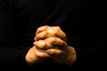 Photo : Hands in prayer  young candle