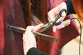 Hands of professional hair stylist with scissors and comb Royalty Free Stock Photo