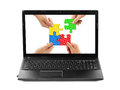 Hands and puzzle in computer notebook Royalty Free Stock Photo