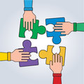 Hands with puzzle, Teamwork Concept